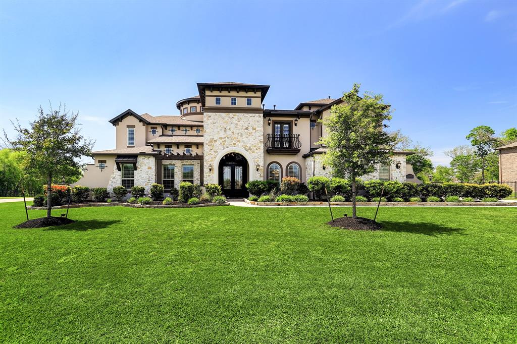 Emerald Luxury Homes with a 3 car Garage on a 1 acre corner lot. 2 Story Dramatic Iron Stairway, Wood and Tile Floors dominate the home, Study with Glass Doors, Dining W/Butler Pantry, Wine, Grotto, 2 Story Living Room with a Two Story Stone Fireplace, Gourmet Kitchen W/Granite Island and Granite countertops, Tall Custom Cabinets, Built In Monogram Stainless Steel Appliances, Master W/Stunning Ceilings, Fireplace, His & Her Granite Vanities, California Closet, Guest Bedroom down W/Bathroom, Media & Game Room W/Entertainment Bar, & additional utility closet 2nd floor. Outdoor Fireplace and a 1100 sq. ft GUEST HOUSE w/Living Room, Kitchen, bedroom and Utility Room. (not included in sq ft.)In addition to no direct back neighbors, the backyard is nicely landscaped, lined with shrubs giving you extra privacy, plus the natural vegetation behind the fence offers more. Room for a large pool. NO MUD tax! Low Taxes! FBISD, Ridge Point HS! Bus stop at entrance of subdivision.