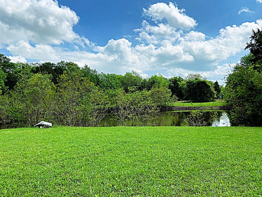 Awesome wooded tract with large pond close to Brenham on approximately 22.75 acres. Secluded, shady and private. Close to Hwy 290 for commuting to Houston or Austin. Between Brenham, Burton and close to Round Top. Ranch style home with approximately 2,336 square feet, has nice yard and patio area, outdoor storage sheds and shop for your outdoor equipment. Features include: sunken den overlooking back of the property, island kitchen, large living area, 2 car garage. With a little remodeling could be a gorgeous ranch house. Great location close to Brenham for shopping, schools and medical facilities. Owner to keep minerals and waive surface rights. Ceiling fan in sun room excluded.