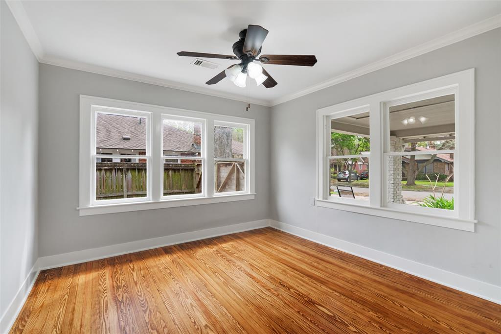 Bedroom # 2 with refinished original wood floors, crown molding and lots of natural light.