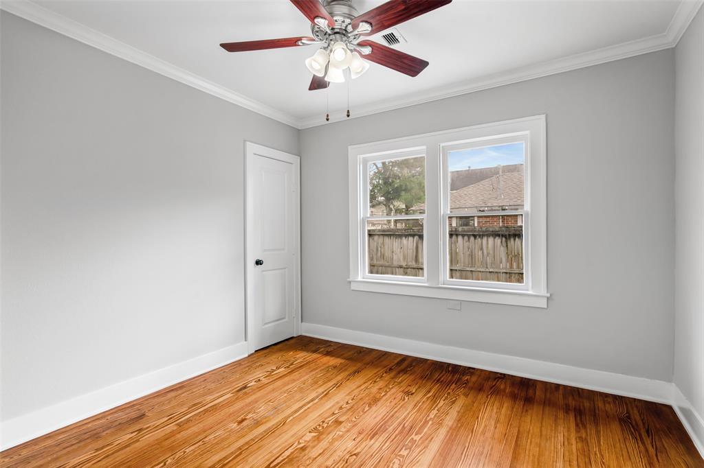 Bedroom # 3 with refinished wood floors and crown molding.