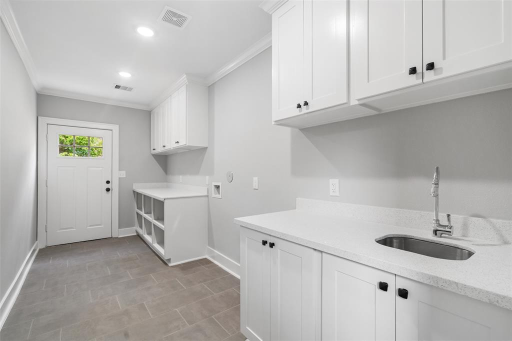 The massive utility room offers a lot of additional storage.