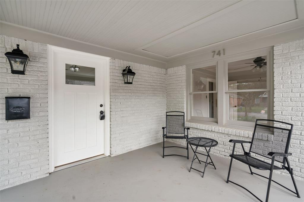 Enjoy your morning coffee on the classic Heights covered porch.