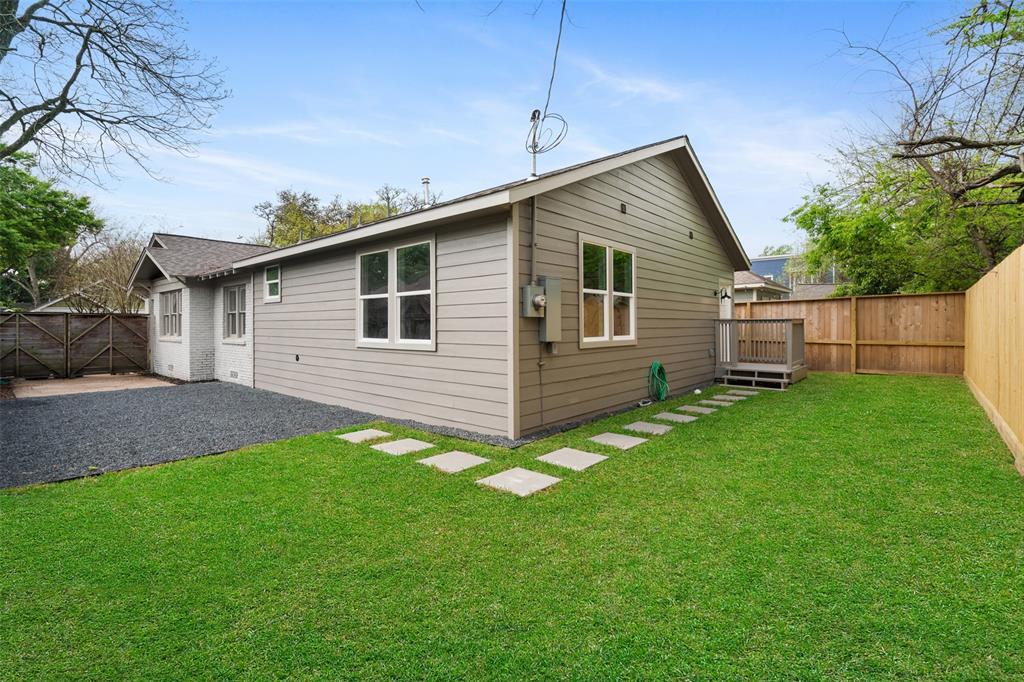 The fully fenced back yard is great for families with kids or pets.
