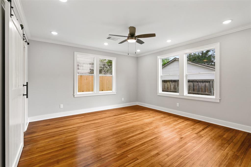 Spacious master suite with walk-in closet, crown molding, recessed LED lights and reclaimed wood floors.