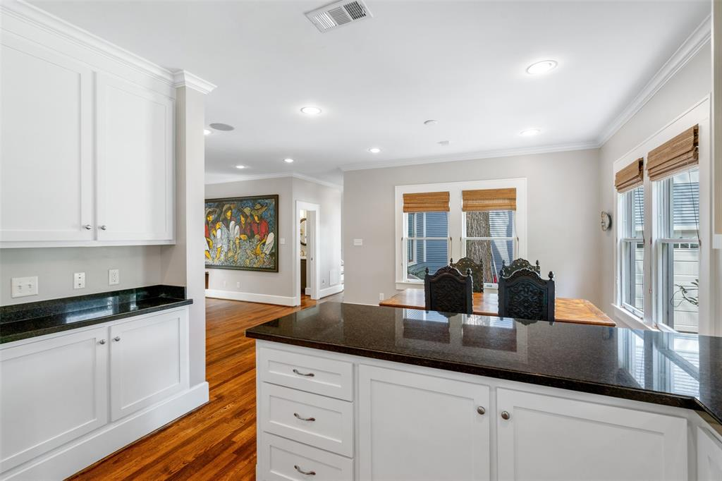 Besides the living room, the kitchen also opens to a breakfast room, which could also serve as your main dining room.