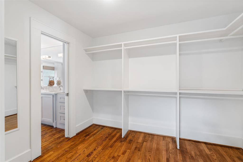 You are going to love the storage in this home and the master closet space is no exception. Here is one of two walk-in closets in the master suite. The hardwood floors extend into the closets as well.