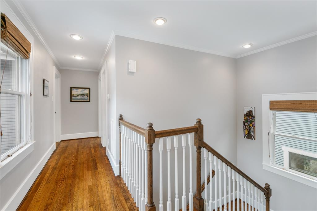 The landing at the top of the stairs features a row of windows that provide great natural light.
