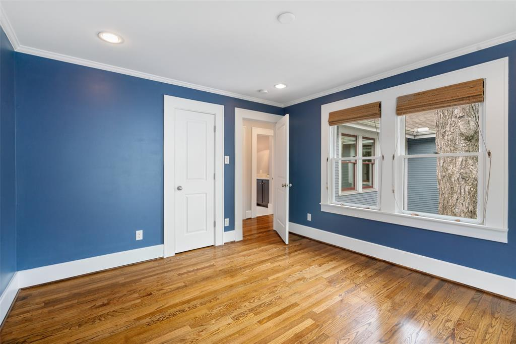 Each of the upstairs secondary bedrooms features large windows and hardwood floors.