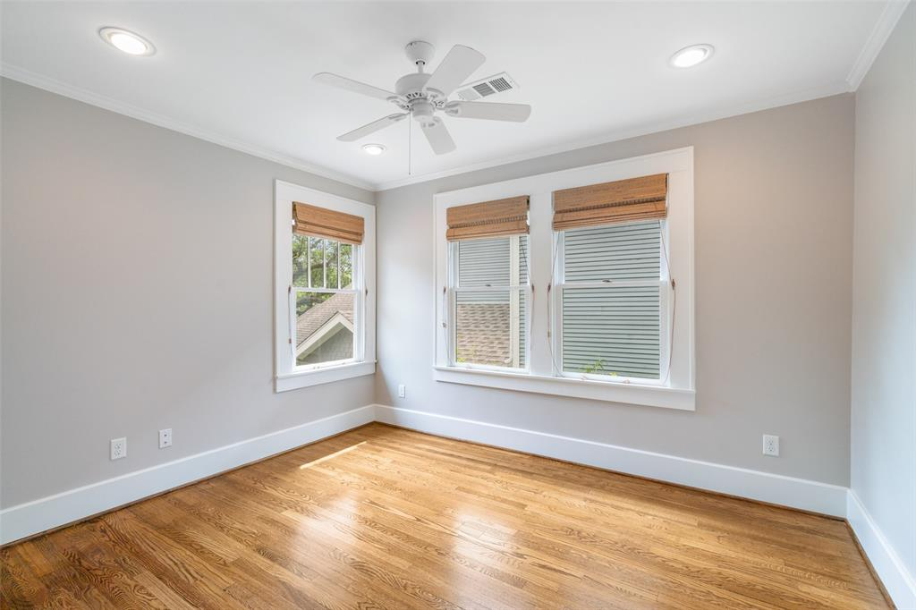 Like the other upstairs bedroom, this bedroom is well lit and provides generous storage.