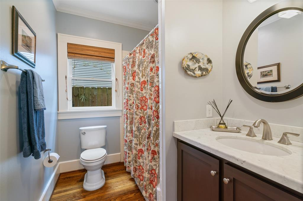 This downstairs guest bathroom in located on the 1st floor and includes a tub/shower combo and a gorgeous marble vanity.