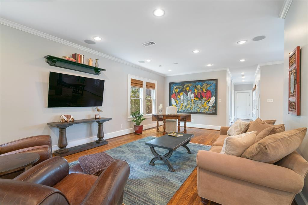 Light floods the home through oversized windows in each room. Per the seller, the speakers in this room and throughout are powered by a Control-4 Home automation system. That system will remain with the home. According to the seller, the Control-4 system can be expanded to control lighting, window treatments, and more.