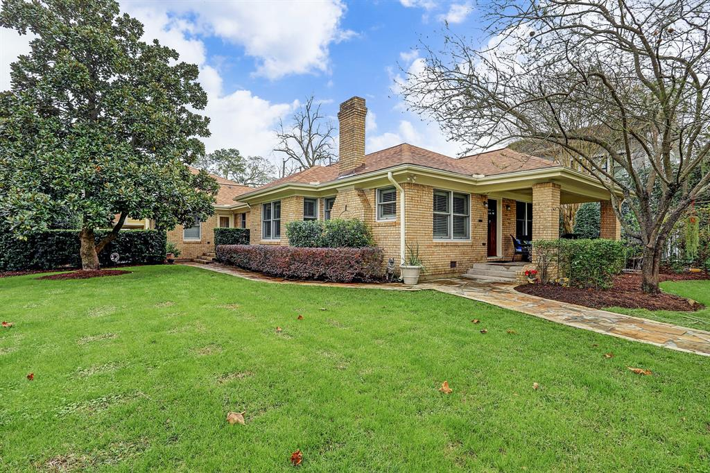Charming & updated Heights home w/ 3 Bed & 2 Bath + recent (2018) oversized Two Car Garage, Two Car Carport & Garage Apartment above. The oversized (9900 sq ft) corner lot is fully fenced & gated. Beautiful flagstone patio & walkways compliment this property. Other 2018 updates include roof & cedar stained backyard fence. The windows, electrical wiring & plumbing were replaced in 2008. The covered front porch welcomes you into generously sized Living & Dining rooms with built in cabinetry & shelving. The eat in Kitchen offers granite counters, two sinks & stainless steel appliances along with an Elmira retro stove & oven. The Master Suite has views and access to the Backyard along with an updated Master Bath with Japanese soaking tub, marble walk in shower & custom cabinetry with dual sinks. The recent garage offers interior & exterior storage, climate controlled interior & wonderful one bedroom garage apartment above. Study could be a 4th bedroom if needed.