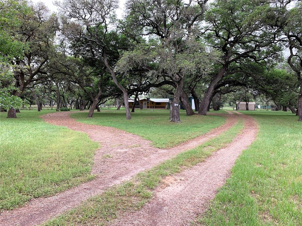 This beautiful country property Forest Oaks Subdivision has a cozy, country home on 13 acres dotted with oak trees.  What a perfect weekend home or a full time residence with Rice ISD right around the corner.  Home is all electric 3 BR, 2 Bath with a large living area and a separate room in the back that is currently being used as a game room.  HVAC and water heater are three years old.  90% of property has had the underbrush cleared leaving only the larger trees making it easy to mow and shred.  There is a small pond in the center of the property with perch, bass and catfish.  Several outbuildings provide storage for your recreational vehicle or hunting and fishing equipment.  There is access to Forest Oaks Water Supply but a new 400' water well is currently servicing the property.  Separate septic and water run to another location on property for an additional home, guest house or rental.  Property is currently ag exempt.  All perimeter fencing and gates were replaced recently.