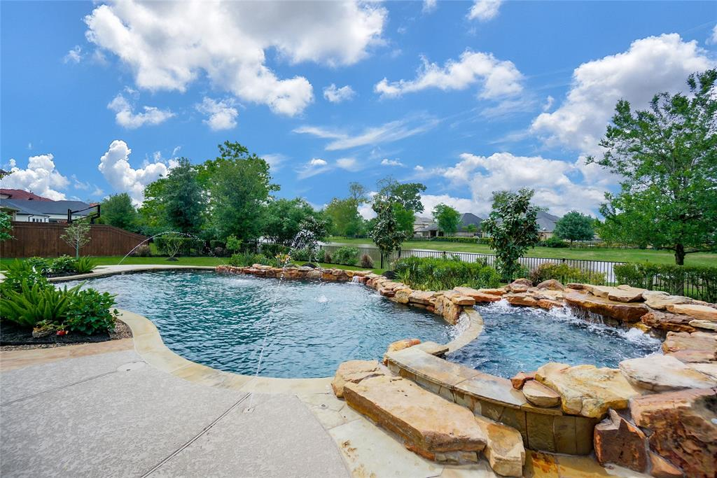 ROCK BOTTOM PRICING - Seller's loss is buyer's gain. Buy this amazing house and get the pool, spa and upgrades for free. Step in to immediate comfort and luxurious design when you enter this beautifully laid out waterfront home. Resort-style pool with spa,Texas sized back patio,almost 1/2 acre lot w/ custom landscaping and waterviews. This home boost incredible finishes & a spacious floor plan made for living and entertaining with downstairs game room and media room. Exquisite chef-inspired kitchen w/ top of the line WOLF appliances,over-sized island a multitude of cabinets that opens to breakfast area & two story family room. Master suite with trey ceilings,remote controlled window coverings with a spa-like bathroom offering over-sized vanities, jetted tub and double shower. Perfectly designed 2nd floor offers 5 secondary spacious bedrooms. Upgrades & amenities include porcelain tile,wood floors,stained wood throughout,plantation shutters,full home surge protector & water softener.