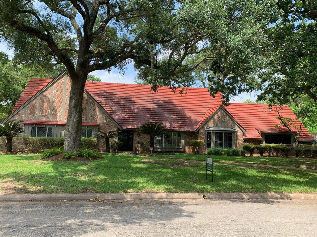 Come see this beautiful home that sits under majestic oak trees. As you enter you will notice a lodge like feel. The spacious first floor is open to the studs and ready to be customized into your dream home! Upstairs you will find two over sized rooms with with huge closets and beautiful wood floors. The backyard is one of a kind with sloping trails to a built-in granite picnic table near the waterfall. There is an ideal spot to add a pool if desired. At night, gather around the fire pit. Also, check out the huge garage with room for 3 cars or a large boat, plus workshop space. What a rare find, a treasure of a home on this prestigious street in a highly sought after neighborhood and school district. It's in a fabulous location in the heart of Memorial with easy access to CityCentre and within walking distance to the shops & restaurants at Memorial Green.  The ideal home to make the next memories of your lifetime in.