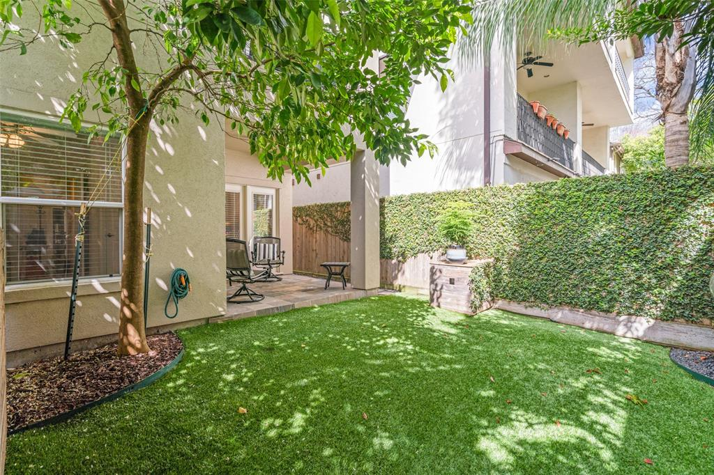 The low-maintenance back yard features artificial turf and offers a great option for families with pets.