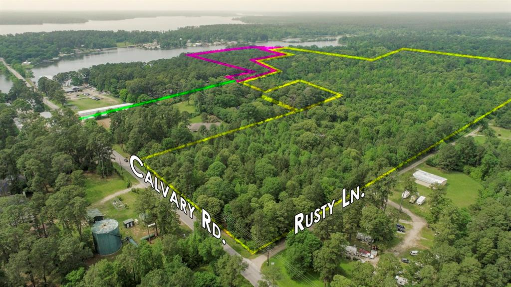 Attention Developers and Investors: Come own one of the few remaining large tracts of land on Lake Conroe. Located in the path of growth up I-45 North and inside Willis ISD, adjacent to the coveted Corinthian Point Subdivision. This property boasts rolling terrain and scattered hardwoods. Has multiple points of access and approximately 1/10th mile of Calvary Road frontage with direct access to Lake Conroe (via adjoining undivided interest). Tie in some of the highest elevations in the area, puts you high and dry in Paradise. Water and sewer services potentially available via the Corinthian Point MUD District. Corinthian Point Subdivision was developed in the 1980s and has an average home value of $315,000 with recent lot sales value above $30,000 for a ¼ acre interior lot. Lake Conroe is located approximately one hour north of downtown Houston (via IH-45). Extending 21 miles in length and covering 21,000 surface acres. The average annual salary for the Lake Conroe area is $80,000.