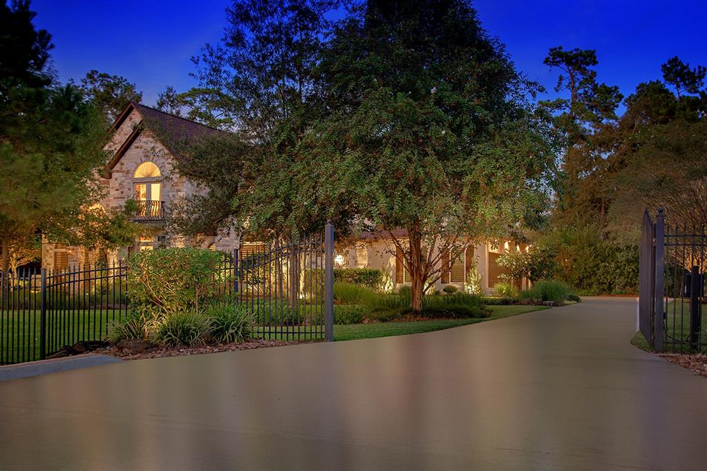 Stunning lake front home in Benders Landing Estates built by Southern Living approved builder, Life Built Homes. This custom home sits on over 1 acre with both water and clubhouse views! Gated entry, whole house water filter, detailed trim work, butler's pantry, wine room, architecturally carved ceilings & abundant windows provide serene views throughout. An aspiring chef's kitchen w/3 ovens, breakfast bar & granite island overlooks the breakfast room & den w/vaulted beam ceiling & stone fireplace; elegant formal dining; study w/ built-ins & library ladder; master retreat & 2nd bedroom down; 3 bedrooms, media & game room up w/balcony; all 5 bedrooms have en-suite baths & walk-in closets; oversized 3 car garage; private backyard paradise w/gorgeous pool w/tanning shelf, spa, outdoor kitchen & fireplace overlooking a stocked lake-fish from your own backyard! Amenities include a clubhouse w/workout facility, pool, parks, soccer & baseball fields. Easy access to Grand Pkwy & The Woodlands!