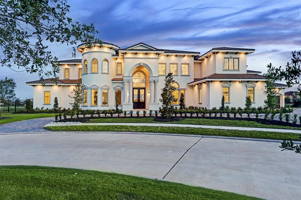 EXPERIENCE THE ULTIMATE IN LUXURY THAT RIVERSTONE HAS TO OFFER! SLEEK, MODERN LUXURIOUS ESTATE SITUATED IN RIVERSTONE'S MOST EXCLUSIVE GATED COMMUNITY OF RIVERSTONE ISLAND - W/ONLY 9 ONE ACRE WATERFRONT HOMES IN TOTAL & HOMES VALUED WELL INTO THE MILLIONS. BUILT BY RENOWNED BUILDER ASHTON GRAY HOMES, YOU WILL BE IMPRESSED FROM THE MOMENT YOU ARRIVE. MAGNIFICENT FRONT ELEVATION WITH TILE ROOF, DRAMATIC FOYER W/TWO GRAND STAIRCASES, SOARING CEILINGS, CUSTOM CHANDELIERS, AND WALL OF WINDOWS TO LET IN THE SPECTACULAR VIEWS OF LAKE RIVERSTONE. INCREDIBLE KITCHEN W/ TONS OF CUSTOM CABINETS, TWO ISLANDS, QUARTZ COUNTERS, AND HIGH-END APPLIANCES PLUS A SECOND CATERING KITCHEN. 3 MASTER SUITES W/2 MASTERS DOWNSTAIRS ALL W/LUXURIOUS SPA-LIKE MASTER BATHS & CLOSETS THAT RIVAL NEIMAN MARCUS. ELEVATOR SHAFT, BONUS ROOM, GAMEROOM, MEDIA ROOM, HUGE WALK OUT BALCONIES, PATIOS, WET BARS, WINE ROOMS, TOO MUCH TO LIST HERE! NEW CONSTRUCTION COMPLETED AND READY FOR IMMEDIATE MOVE IN! **SEE LINK TO VIDEO**