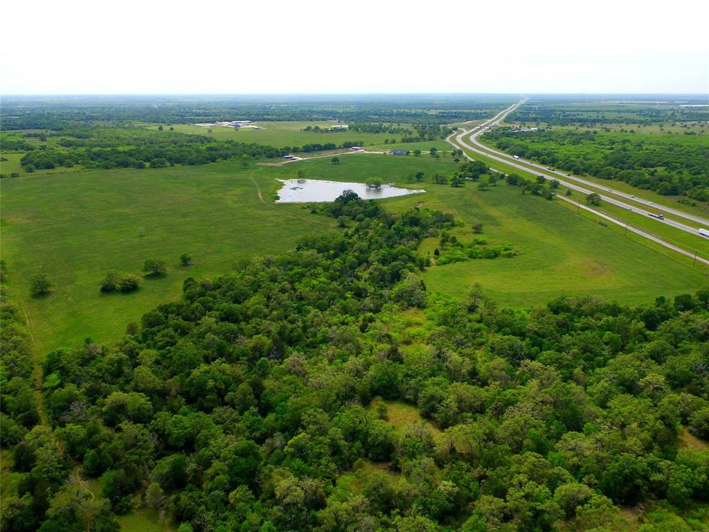 Great road frontage,commercial potential,pasture and horse property,located near San Antonio, Austin & Houston, 108 Acres, 2 Acre pond.