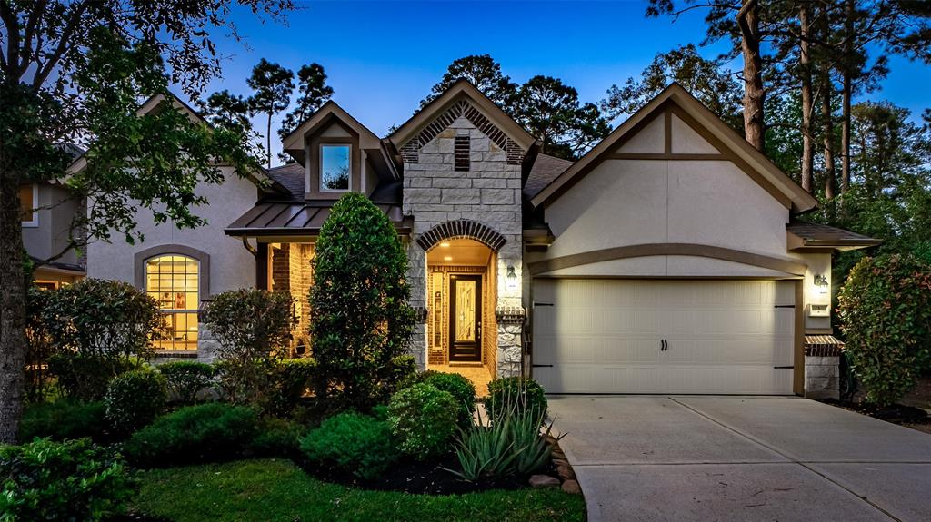 """This lovely one story sits at the end of a cul-de-sac, siding to a reserve and overlooking a pond with a 5 minute walk to Creekside town center and HEB. Upgrades include gorgeous tile throughout entry, kitchen and family with wood floors in dining and study. Study could be 4th bedroom.  The island kitchen has """"leather"""" look counters, glass tile backsplash, double ovens and breakfast bar. The large master overlooks the lush outdoors which includes a slate tile covered porch and an extension of flagstone patio. A covered porch entry with brick walk, makes a gracious entry to this amazing home."""