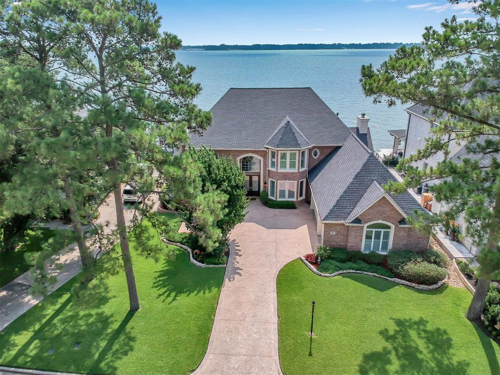 Lovely waterfront home! Custom built by top builder Rockey Butler, Tuscany Homes. Beautiful open floor plan home with walls of windows overlooking one of the best open waterviews on Lake Conroe! New roof Oct. 2019, 3 new A/C's in 2016. Foundation has 53 Bell bottom builders piers.  Huge gourmet kitchen with island open to family room, Master Suite down, large secondary bedrooms, 3 full and 1 half baths, 2 fireplaces, Wrought Iron curved foyer staircase, formal study, living, dining, family room, game room, 2 huge walk in attics, 3 1/2 car garage with workshop, boat dock and lift, Electric lift in garage to story boat trailer up against ceiling, etc. etc. Come and imagine yourself and guests sitting on the balcony, porch or decking and watching the Showboat Empress coming by or the Lake Conroe boat parade.