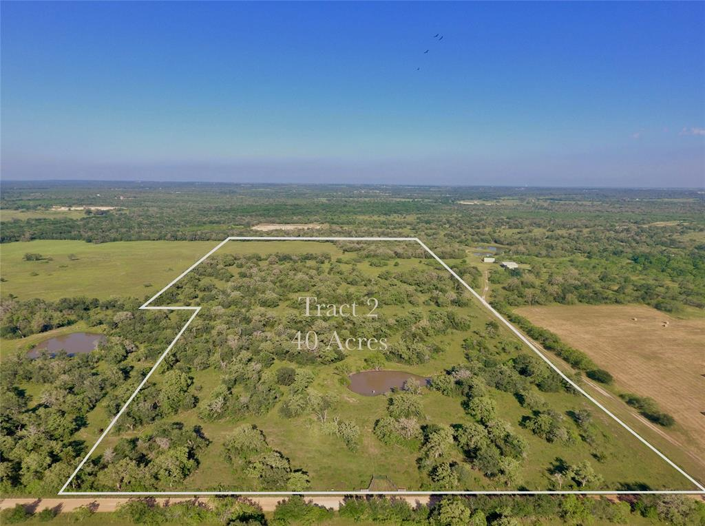 TRACT 2 : 40 +/- Acres centrally located between San Antonio,Houston and Austin.  Bring your ATV, hunting and fishing gear  and enjoy the country.  Or if you're looking for a home site this size tract will give you privacy and acreage to enjoy. The property has a great shape, mature mixture of oaks and large pond containing bass and catfish. Property is currently used for cattle grazing, hay production and  recreation. It has good fencing and cross fencing.  Soil is mostly fine Sandy laom. Isn't it time to move to the country to be self sufficient/reliant and build your off the grid dream place? Property is located in the Moulton School District. Additional acreage adjourning this tract is available. New survey will be needed to verify boundaries and acreage size.  
