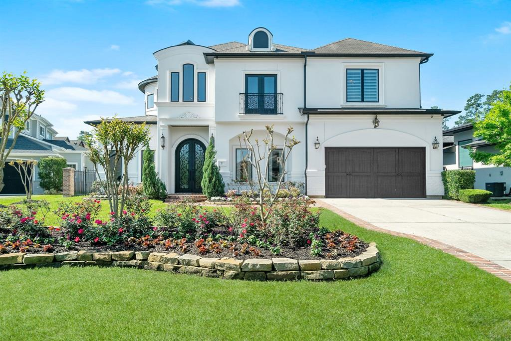 Stunning soft Contemporary offers refined living with a warm and elegant atmosphere. Incredible entertaining home, custom designed by Eclectic Interiors in New Orleans showcases brick accents throughout, fabulous designer lighting, and a one-of-a-kind walk in climate controlled wine room.Year-round entertaining is easy with large covered patio and a fully outfitted summer kitchen, pool with fire-bowls and waterfall. Inside highlights an open concept living with large family overlooking backyard and 2 staircases, plantation shutters, wood floors and open floor plan.The grand entryway with a wide entry area and a grand staircase to catch the eye. A wall of windows is the perfect backdrop to the home's family room and breakfast areas. Kitchen highlights Viking appliances, a large working island & abundant storage. Master retreat with large master closet. Upstairs has four additional en-suite bedrooms, game room, media room, an exercise room, craft room, and an additional flex room.