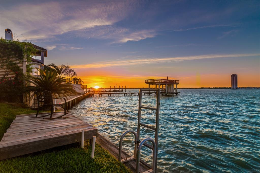 DISCOVER COASTAL LIVING IN THE HEART OF LEAGUE CITY; WITH PANORAMIC VIEWS OF CLEAR LAKE FROM THE LARGE AND TASTEFUL LIVING ROOM AND SPECTACULAR VIEWS FROM THE MASTER BEDROOM, THIS IS WATERFRONT LIVING AT ITS FINEST; SPACIOUS WATERFRONT TERRACES ALLOW YOU TO ENJOY THE SOUNDS OF LAKEFRONT FUN ON THE WATER; FABULOUS HOME OFFICE WITH FRONT ROW SEATS OF CLEAR LAKE,  THIS FOUR-BEDROOM FAMILY RETREAT FEATURES A MASTER SUITE WITH SITTING AREA AND SUN ROOM, LARGE LIBRARY WITH CUSTOM BUILT-IN BOOKCASES, HUGE FORMAL DINING ROOM, ONE BEDROOM HAS CUSTOM BUILT-IN BUNK BEDS FUN FOR THE KIDS AND HARDWOOD FLOORS. ADDITIONAL AMENITIES INCLUDE 60' OF WATERFRONT FRONTAGE, A FOUR CAR TANDEM GARAGE, LARGE COVERED PATIO, BOAT HOUSE CAN BE BUILT ON CANAL SIDE OF PROPERTY (SELLER HAS PLANS); AND FRONT OF HOME HAS BRICK PAVED COURTYARD LEADING TO THE PRIVATE ENTRY AREA.