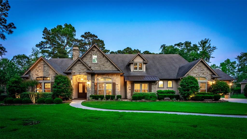 This is a beauty, I promise.  Built by one of The Woodlands renowned custom builders, this one story estate sits on 1.2 acre overlooking the Lake Windcrest Golf course through a canopy of trees.  The inside of the home has all the beautiful appointments of a quality custom home including high ceilings with exposed beams, wood and tile flooring in the main areas,  elegant built-ins, a gourmet kitchen with Thermador appliances, cabinets with pull-out drawers, 166 Bottle wine cooler, and plantation shutters.  Upstairs is heated and cooled and ready for an extra bedroom or media.  Outdoors is a large, covered, entertainment area with natural stone fireplace. The real stone is  in keeping with the exterior of the home. Add to this a magnificent pool, spa and pergola for the full look topped off by wrought iron fencing surrounding the property and gated drive.  Just too many features to list here so come see.