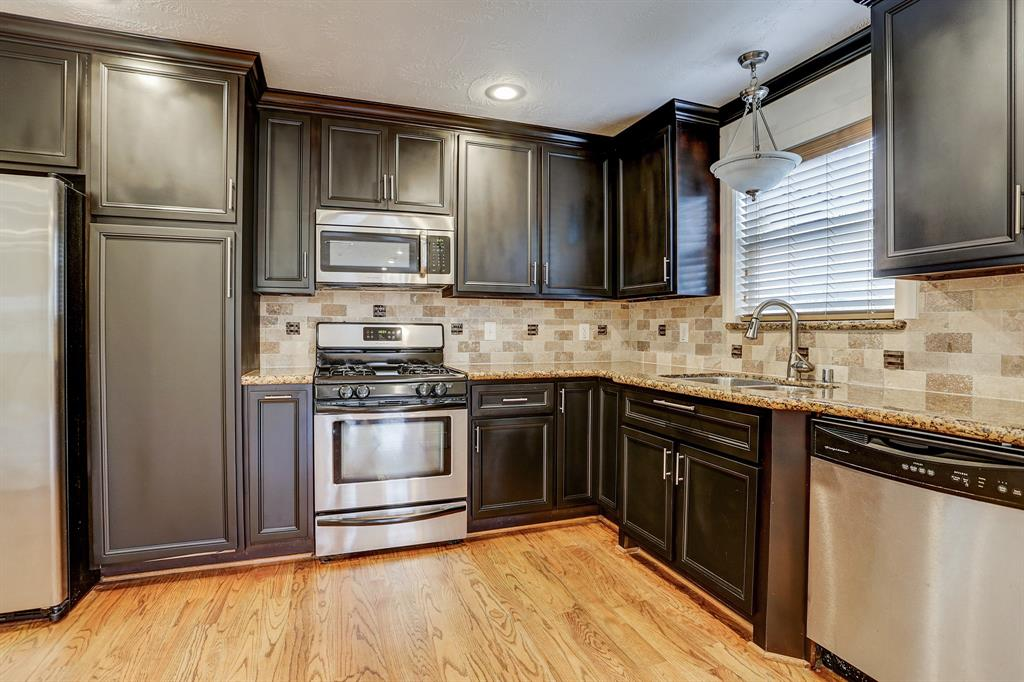 Granite countertops, room to add a decorative island piece to prep food and all appliances included!