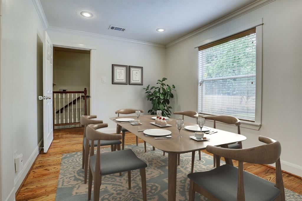 Breakfast/dining area virtually staged. Enjoy your morning coffee with a great view to the backyard.
