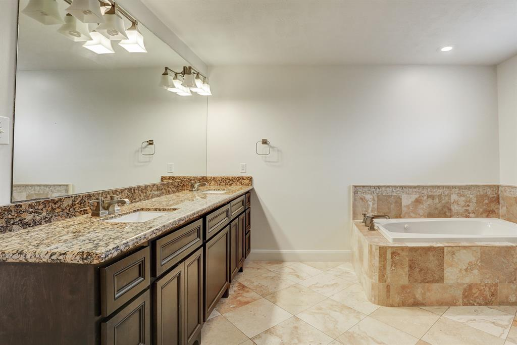 Master bath with double vanity, soaking tub, and separate shower!