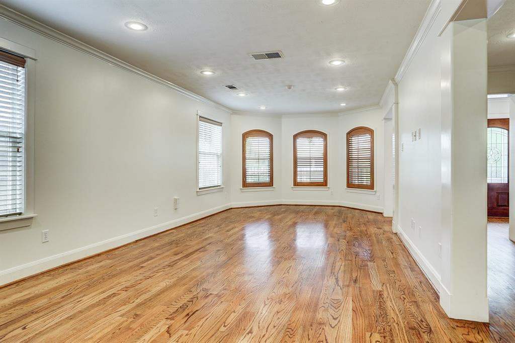 Spacious living room with beautiful pronounced doorway moldings and great natural light.