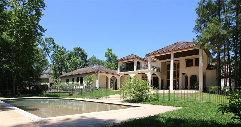 RARE FIND- Large Custom Home on a stunning wooded 1.25 acre lot backing to the George Mitchell Nature Preserve, the ultimate LOCATION in The Woodlands! Priced at near Lot Value, in coveted Cascade Canyon, located between both Carlton Woods golf courses, minutes to John Cooper School and highly rated public schools - TWHS! Mediterranean style home with panoramic views of the permanent reserve with trees as far as you can see.... Key features include an estate sized lot, pool, circular driveway, 4 car garage w/gated parking court, long life concrete tile roof, a separate guest suite/casita with full bath, travertine flooring, island kitchen with two copper sinks and Thermador range! Open floor plan and walls of windows with access to the backyard oasis, covered lanai and balconies are perfect for enjoying outdoor living. Amazing backyard with room for your own tennis court/sport court, too! Homesites this size and private are rare! Imagine all this can become... bring your design plans!
