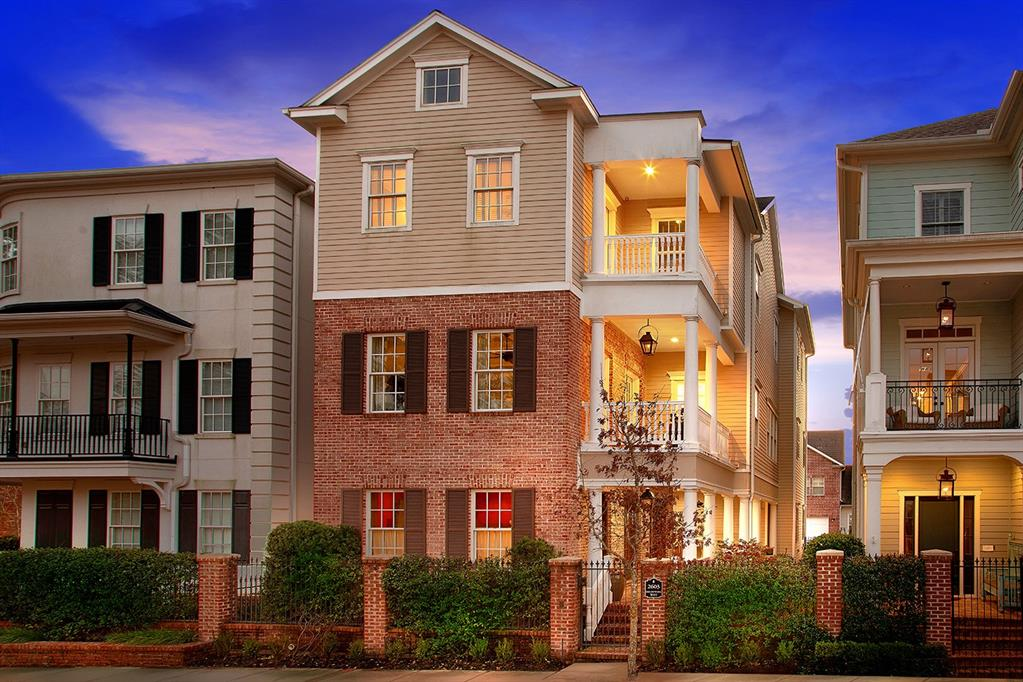 Spectacular 3 story home in East Shore! Known as the Garden District, East Shore offers a clubhouse with exercise room, pool, barbecue pavilion and event room with Viking kitchen and fireplace, Ellipse Park, as well as miles of hike/bike trails around Lake Woodlands. Covered front porch and balconies, soaring ceilings, stunning hardwood and tile flooring, architecturally carved ceilings, incredible wine room, detailed trim work, built-ins, and an elevator for convenience. Game room downstairs; Main living on the 2nd floor features an open concept island kitchen with breakfast bar (fridge included) and butler's pantry, formal dining, den with gas log fireplace and study with French doors; master retreat and 2 guest bedrooms on the 3rd floor. Oversized 3 car garage too!