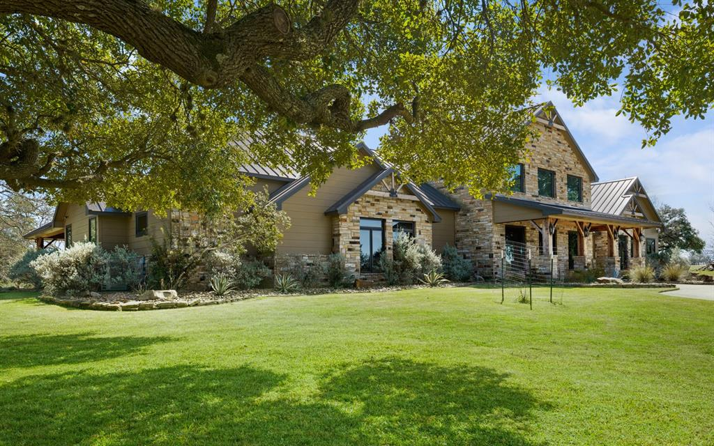 Ultimate hunting & fishing ranch within 1 hr & 15 min from downtown Houston.  This truly unique 413 ac high fenced property is world class in design & amenities.  From the beautiful custom gated entry, to the 8 bdrm, 7-1/2 bth lodge, to the shop bldg & every other amenity, the quality & craftsmanship are impeccable.  Entering the lodge, the great room with its floor to ceiling fireplace is spacious & built for entertaining.  Behind the great room is the all inclusive island kitchen/dining area with beautiful granite countertops.  Outdoor features a full length back porch overlooking the fire pit, BBQ area, & children's play area.  The shop building has an office and man cave.  A hunting paradise with exotic species such as Axis, Fallow, Blackbuck & more.  Sporting clay bldg doubles as one of the 5 hunting blinds.  Multiple feeders & breeding pens.  Approx 200 ac of water on this spectacular ranch make for excellent duck hunting & fishing!  This is a one-of-a-kind ranch.