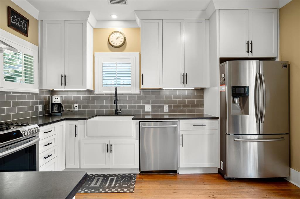 Among other things, the kitchen here was so thoughtfully and beautifully updated by the current owners.  Cabinet space is absolutely maximized and the finishes are sleek and neutral, including that fabulous white farm sink. The window to the left overlooks tree lined Wendel St.