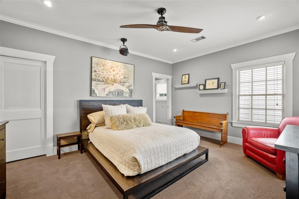 This lovely, quiet primary bedroom suite addition by prior owners sits at the back of the home on the second floor.  The door to the left is to a walk-in closet (which can be seen in the Matterport tour), the full bath is to the right.