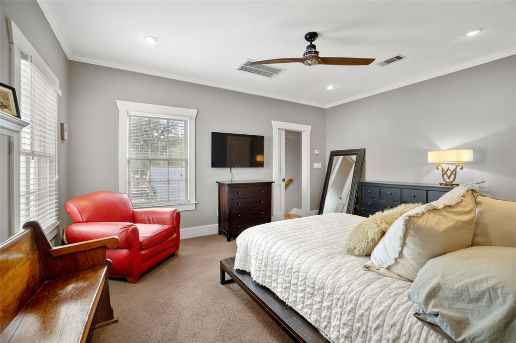 This primary bedroom has wonderful light and very good space for various furniture arrangements.  Through the door to the right you can just see the handrail to the stairway leading down to the family room and main level of the home.