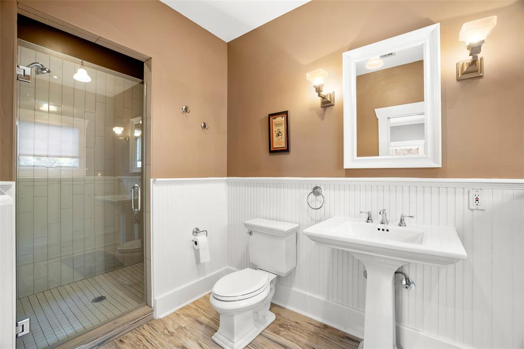 The primary bath was also beautifully updated by the current owners.  The oversized shower stall includes a bench and frameless glass door.
