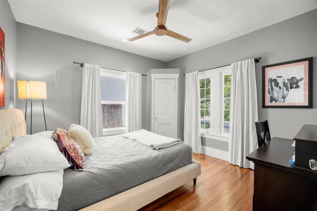 This second bedroom comfortably accommodates a queen bed and a home office set up.  The window to the right overlooks Wendel St.