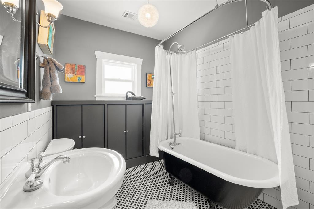 The full bath on the first floor is quite big, with excellent storage and a classic claw foot tub/shower.