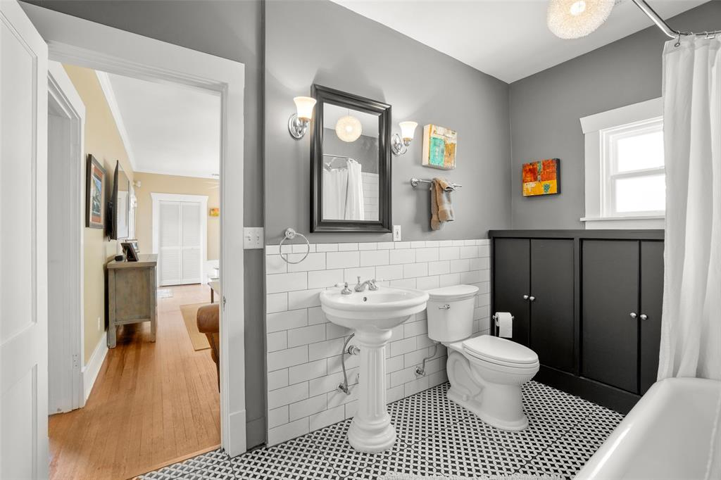 This bath is conveniently available to both the family room and guest bedroom.  Again classic finishes were carefully chosen to accentuate the historic era of this bungalow.