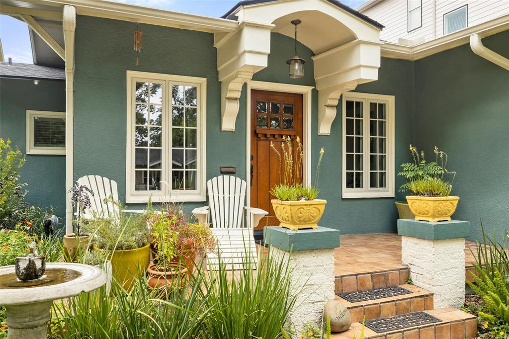 There are so many beautiful accents on this home, from the paneled windows to the architectural front door portico to the terracotta tile of the front porch and columned stairs.  The current owners are avid gardeners, the landscaping here is just perfect.  What a pretty spot to enjoy a cool morning and coffee!