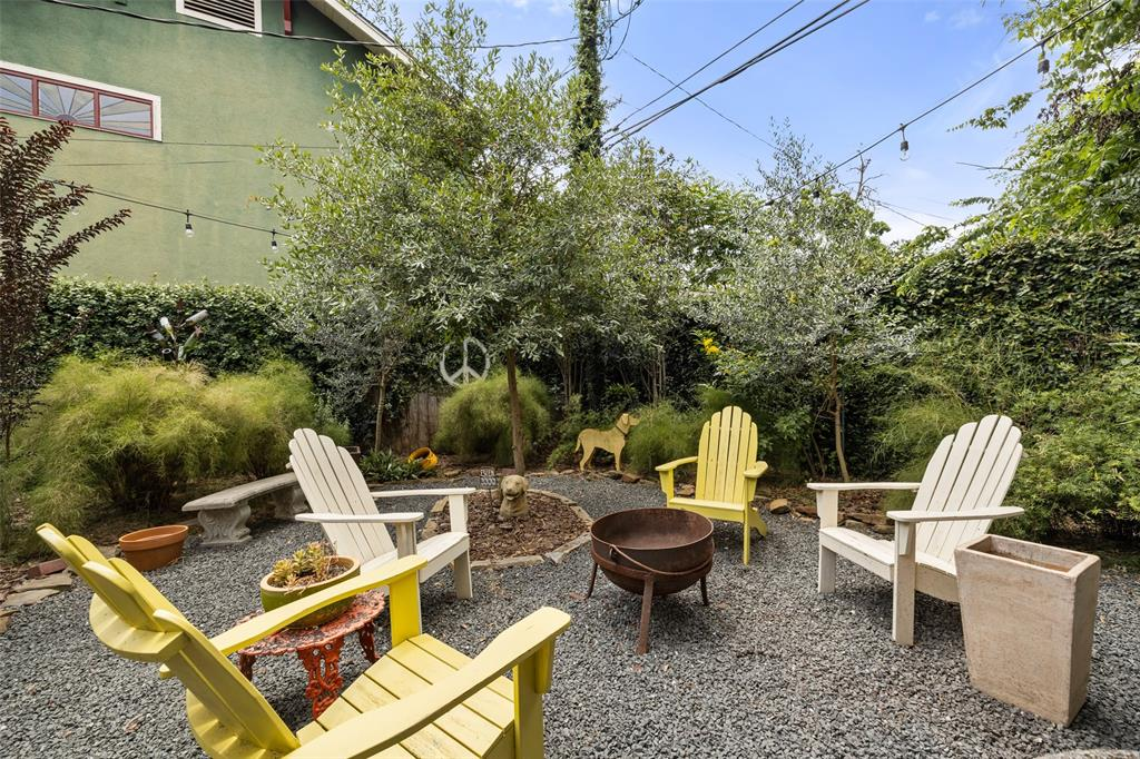 Just beyond the fabulous deck is yard space so thoughtfully landscaped and virtually completely private.