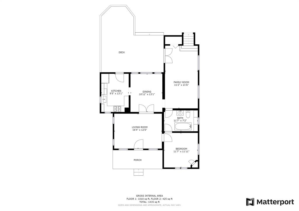 The first/main level floor plan, where you can see the stairs at the back right leading to the primary bedroom suite.