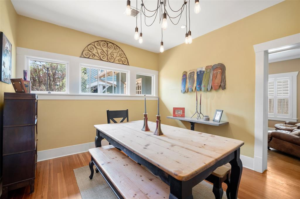 Sitting ideally between the living and family rooms and the kitchen is the spacious and bright dining room.  It will very comfortably accommodate a rectangular or round table set up, as well as additional side furniture.  Also great walls for art!