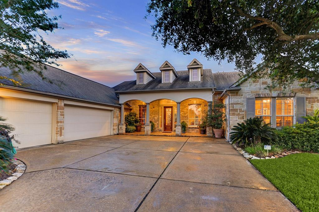 """A Must See! Welcome to this waterfront home on an over-sized lot within Telfair. Every site-line & touch point has been well thought out. From the metal inlays at the entry to the fully equipped outdoor living area and pool in the back, you will see the quality choices throughout the home. This original owner's """"green thumb"""" is evident in the meticulous landscape and gardens. This 3-bedroom, 3.5 bath one story home has a secondary flex room or living space, originally called a children's retreat which can configured into a 4th bedroom. Ample storage has been considered, from the custom cabinet wall in the utility room to the wrap-around kitchen cabinets and the 3-car garage. The study features include a coffered ceiling, floor to ceiling built-in cabinets, shelves, and 8 ft French doors. Shutters & blinds provided. The fully covered 400+ sf outdoor living area can be used year-round. The pool features 30 year """"pebble-tech"""" surfacing, hot tub & four water features. Shows beautifully!"""