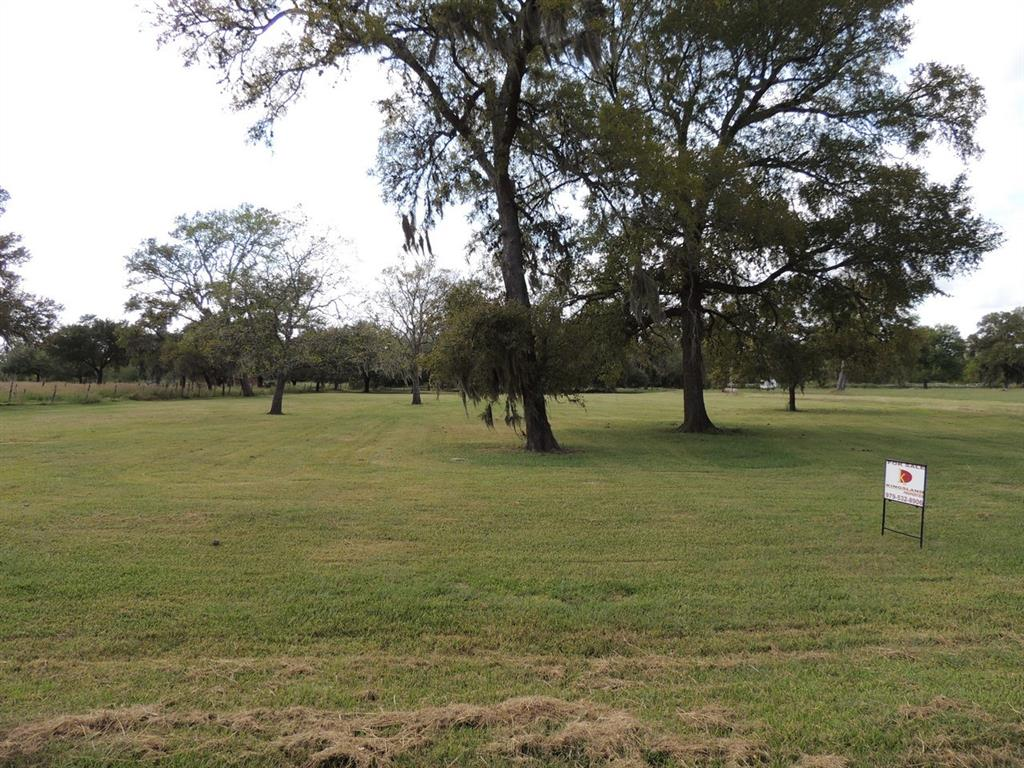 This 5+/- acre tract is amazing! Large shade trees and lush green grass.  Build your home in the country and enjoy the peace and quite!  Best of all its only minutes from 59 and WalMart!
